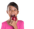 Young Asian Malay Teenager Eating Red Apple III Royalty Free Stock Photo