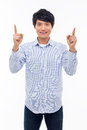 Young asian man indicated upside isolated white background Royalty Free Stock Images
