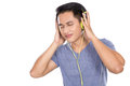 Young asian man listening to music with a headset Royalty Free Stock Photo