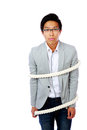 Young asian man tied with ropes isolated over white background Stock Photos