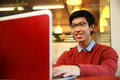 Young asian man using laptop cheerful Royalty Free Stock Images