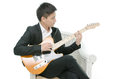 Young asian musician playing a guitar Stock Photos