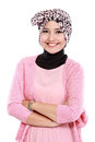 Young asian muslim woman in head scarf smile with arms crossed Stock Images