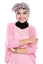 Young asian muslim woman in head scarf smile with arms crossed Stock Photo