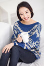 Young Asian pretty woman having a cup of coffee. Royalty Free Stock Photo