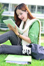 Young asian student have good new beautiful woman learning with computer tablet Royalty Free Stock Image