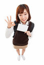 Young Asian student showing empty card