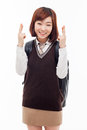 Young Asian student showing lucky sign