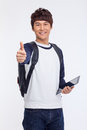 Young Asian student using pad PC Stock Photography
