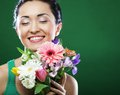 Young asian woman with bouquet flowers happy Stock Photos