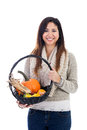 Young asian woman with fall harvest basket of pumpkins gourds and indian corn isolated on a white background Stock Image