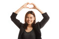 Young Asian woman gesturing  heart hand sign. Royalty Free Stock Photo