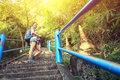 Young asian woman hiker climbing on stone stairs to mountain peak Stock Photography