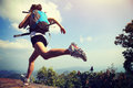 Young asian woman hiker running on mountain peak Royalty Free Stock Photo