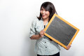 Young asian woman holding blank black board Royalty Free Stock Photo