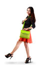 Young asian woman holding handbag isolated over white with clipping path Royalty Free Stock Image