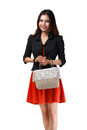 Young asian woman holding handbag isolated over white with clipping path Royalty Free Stock Photos
