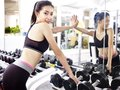 Young asian woman working out in gym Royalty Free Stock Photo