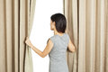 Young asian woman opening curtains for any use Stock Photography