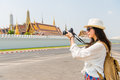 Young asian woman photographer taking picture Royalty Free Stock Photo