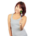 Young asian woman with a picec of brocolli Stock Photography