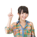 Young asian woman pointing up pretty isolated on the white background Royalty Free Stock Images