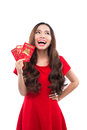 Young asian woman with praying gesture wishing you good luck. Chinese young woman showing the lucky money. Young chinese woman hol Royalty Free Stock Photo