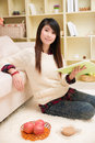 Young asian woman reading book at home Stock Photos