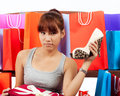 Young asian woman with shopping bags and new shoes isolated Royalty Free Stock Photography