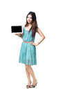 Young asian woman showing empty display of electronic tablet isolated over white with clipping path Royalty Free Stock Image