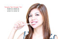 Young Asian Woman smiling and brushing her teeth Stock Photos