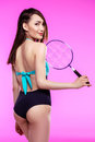 Young asian woman in swimsuit holding badminton racquet isolated on pink Royalty Free Stock Photo