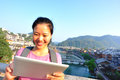 Young asian woman use tablet pc tourist at fenghuang ancient town china Stock Photos