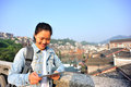 Young asian woman use tablet pc tourist at fenghuang ancient town china Royalty Free Stock Image