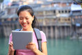 Young asian woman use tablet pc tourist at fenghuang ancient town china Stock Images