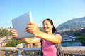 Young asian woman use tablet pc tourist at fenghuang ancient town china Stock Photography