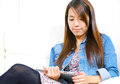 Young asian woman using tablet computer Stock Photography
