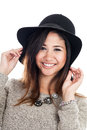 Young asian woman wearing a hat portrait of mid s isolated on white background Stock Photo