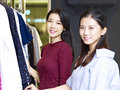 Young asian women in clothing store Royalty Free Stock Photo