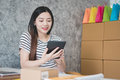 Young asian women entrepreneur working in a home office Royalty Free Stock Photo