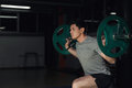 Young athlere training lunges with barbell. sport, bodybuilding, lifestyle and people concept. Royalty Free Stock Photo