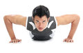 Young athlete attractive push up attractive push up a close of a man doing ups with an intense expression on his face Stock Photo
