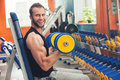 Young athlete lifting weights in the gym Royalty Free Stock Photo