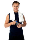 Young athlete posing with water bottle Royalty Free Stock Image