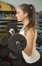 Young athlete woman working with barbell years old Royalty Free Stock Photography