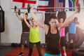 Young athletes lifting barbells against flags Royalty Free Stock Photo