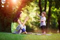 Young athletic girl with child doing exercises outdoors Royalty Free Stock Photography