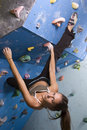 Young, athletic girl climbing Stock Image