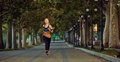 Young athletic girl runner jogging in park in  summer autumn Royalty Free Stock Photo
