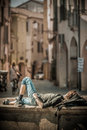 Young athletic man rests warm sunshine enjoying view european street architecture Royalty Free Stock Photos
